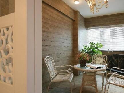 北欧别墅休息区藤椅装修设计