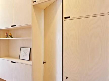 现代简约四居室卧室原木色隐形门装修效果图