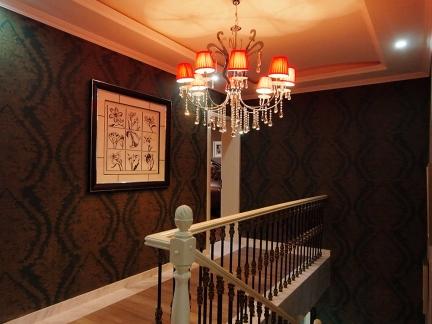 咖啡色大气别墅简欧装修样板间楼梯实景图