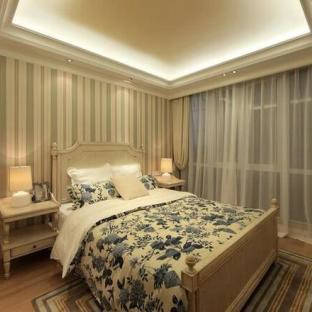 田园风格三居室卧室装修效果图