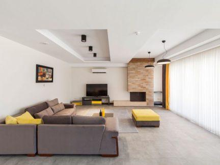 现代风格时尚三居温馨客厅装修实景图