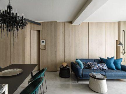 别致现代风格客厅蓝色布艺沙发实景图