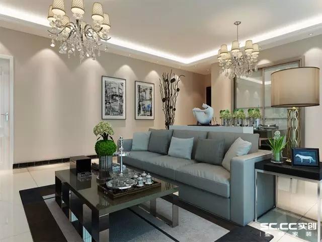 干净的大理石釉面砖使整个空间温暖明亮,瓷质感的工艺品和花瓶搭配净面暗纹带有质感的布艺沙发,低调又不失格调。