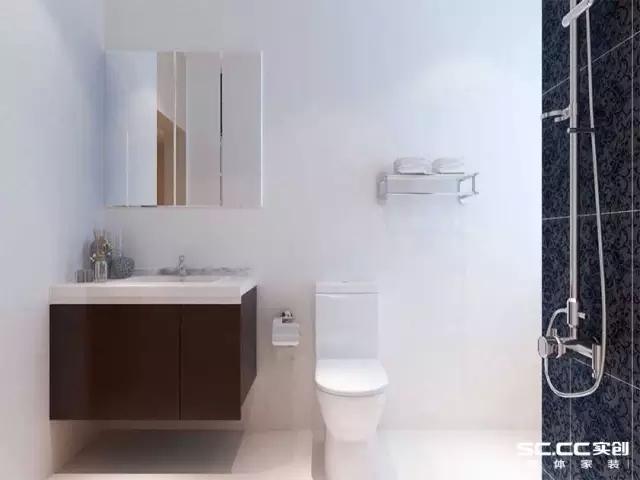卫生间采用深棕色储物柜和白色的卫浴搭配,对比鲜明。洗浴区的暗花深色大理石拼砖,是一个比较突出的亮点,更凸显了业主的品味 。
