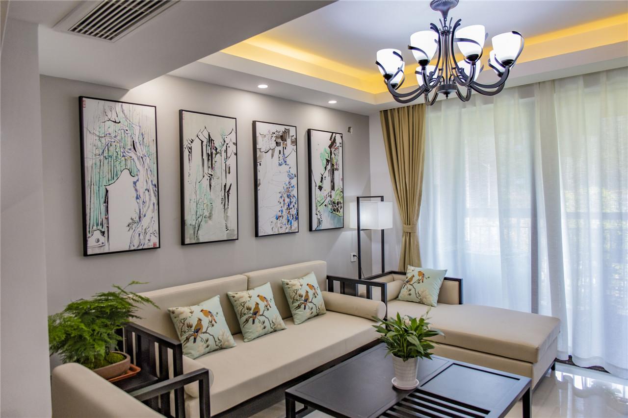 新中式风格,整体色调是黑、白、灰。墙壁主要是灰色的,楼梯、天花板等用了白色,沙发等软装以米白色为主,其他家具以及装饰边框是深色的。