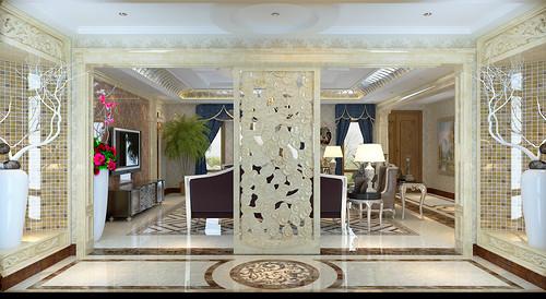 过道门厅处两侧以马赛克装饰内部,以细腻雕花为门栏,硕大花瓶里插着干枝营造意境,一扇堆叠祥云图案的屏风,若隐若现的增加客厅的写意风情。