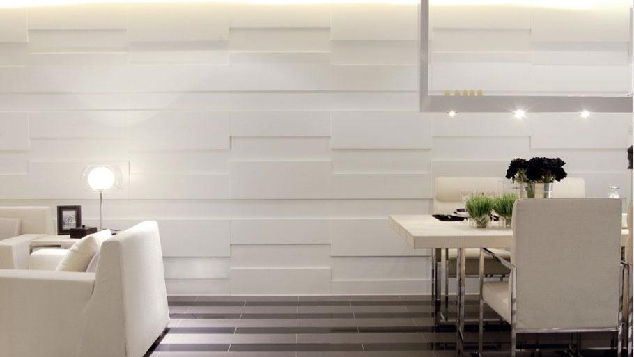 """设计理念:面对生活方式已经被西化的年轻的消费群体,本案的三房单位以""""摄影师之家""""为主题,展现的是一种个性张扬、充满创意的生活空间。吧台、浴缸和开放式厨房被搬进居室,并定义着使用者的生活方式。空间设计上采用尽量开放的设计手法,包括开放式厨房、工作室和通透的卫生间设计,在白色调的映衬下实现空间的最大化处理。?"""