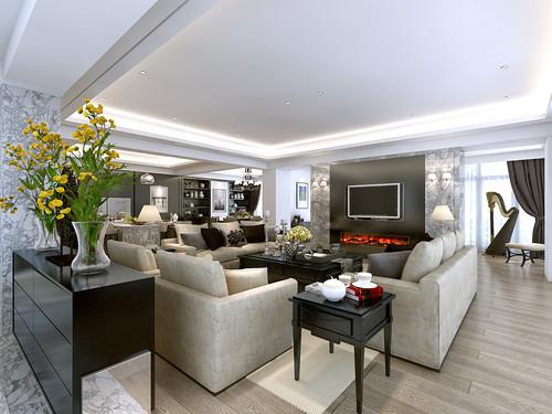 客厅客厅以折中主义表达出极简的质感,以米色系布艺沙发环绕空间,形成方圆得体的布局;嵌入式壁炉彰显了后现代设计在空间中的新形式,涵而不露,黑橡木制成的茶几和边几可谓精巧实用,庄重也优雅。