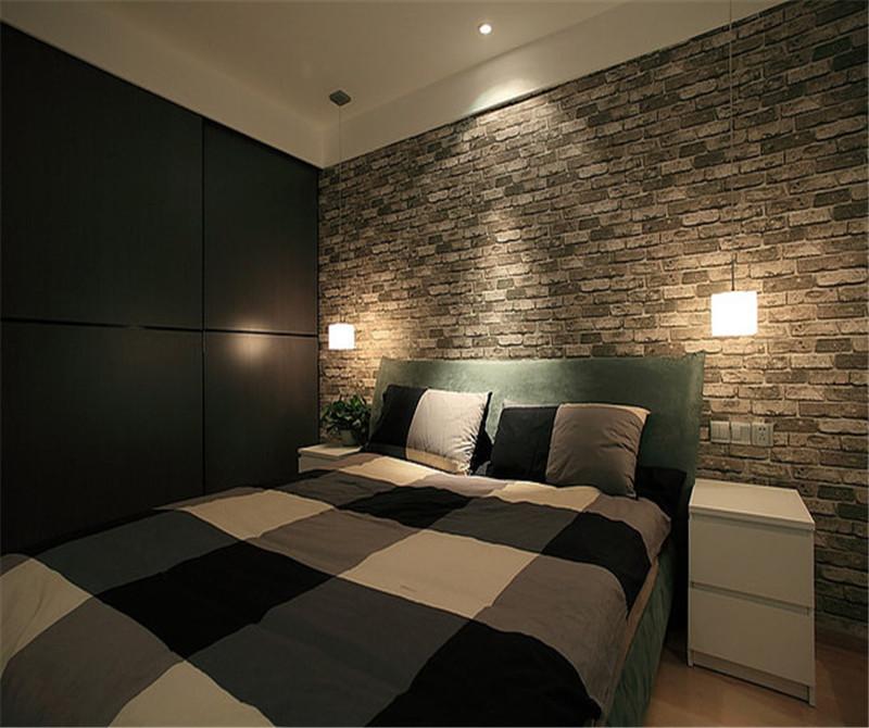 卧室的背景墙选择了砖块一样的,非常特别。床单是白色灰色 的格子床单。