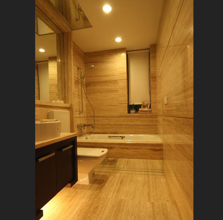卫浴空间中整体选用石材墙体打通整体,简洁大气的同时整齐划一。